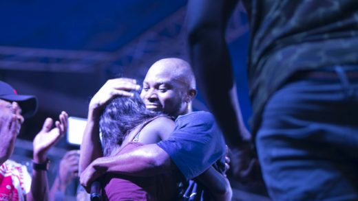 King Promise hugs a girl at Republic Hall Artiste night